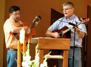 Bro. Juan Acuna, C.PP.S. and Rev. Vince Wirtner, C.PP.S. lead music during mass. (Picture by Jean Giesige)